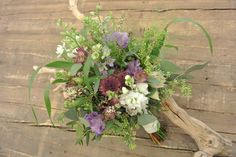 Bridal bouquet with larkspur, astrantia, blushing bride, stocks, lisianthus, thryptomene, ornamental grass and eucalyptus. Designed by Forget-Me-Not Flowers.