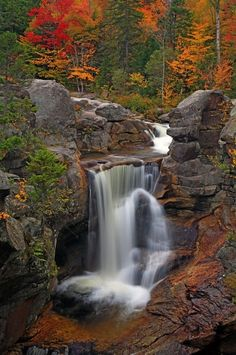 An autumn view of Screw Auger Falls in Grafton Notch, Maine. The Appalachian Trail passes through this rugged and scenic notch, nestled below two of Maine's 4000 foot peaks, Old Speck and East Baldpate. Photo by Tim Seaver.