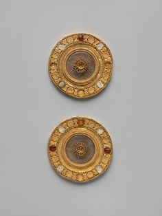 Pair of gold and rock crystal disks, set with garnet and glass inlays   Etruscan   Late Archaic   The Metropolitan Museum of Art