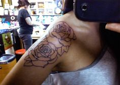 I really like this maybe ill get roses like this from my bicep going up too my shoulder with the butterflies sitting all through the pedals yaaaa thats hottt