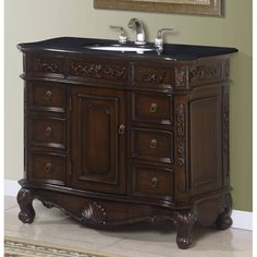 This single sink bathroom vanity cabinet features a beautiful granite top and ogee/beveled edges. The center door opens to a shelf, with six small drawers on the side and a top felted drawer (left and right).