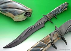 This is one of Broadwell's earlier sub hilts with an integral guard and sub hilt. Materials are damascus steel and fossil walrus ivory. Broadwell Studios