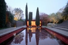 Red Pool | Ricardo Bofill  Completed in 1975, the residence was built around the ruins of an old farmhouse.