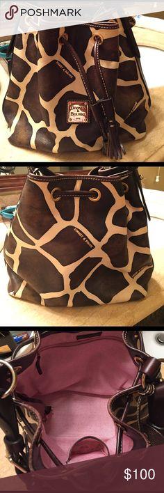 Dooney & Bourke Handbag Giraffe Print Brown/Cream Authentic Dooney & Bourke Handbag.  This handbag is like new in excellent condition.  Adjustable shoulder strap. Dooney & Bourke Bags Shoulder Bags