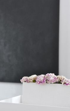 simple black complimented with flowers, perfect little vignette