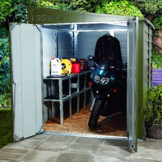 Trimetals Motorcycle Garage A strong and secure storage unit that keeps your motorcycle out of sight and protects it from vandals, thieves and bad weather. Made of sturdy, PVC-coated galvanized steel and available in 3 sizes. Motorbike Shed, Motorcycle Storage Shed, Motorcycle Workshop, Motorcycle Garage, Bike Storage, Garage Storage, Secure Storage, Motorcycle Shop, Garage Velo