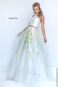 A beautiful beaded and embroidered two piece gown by Sherri Hill! New for 2016 is this Elie Saab inspired two piece with a silky halterneck top and floral embroidered and beaded skirt. Perfect for summer events, would even make a perfect alterative wedding dress! Only available in Ivory. Don't see your size or colour? Contact us and we can special order it in for you!