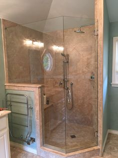 Frameless Shower with a door and a neo- angle notched panel, Cresent style handle, in Chrome finish