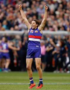 Marcus Bontempelli of the Bulldogs celebrates as the final siren sounds during the 2016 Toyota AFL Grand Final match between the Sydney Swans and the...