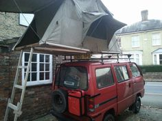 Suzuki carry expedition with roof tent.