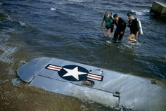A Civil Air Patrol rescue team aids a pilot whose plane was downed outside of Long Island, May 1956.Photograph by Jack Fletcher, National Geographic