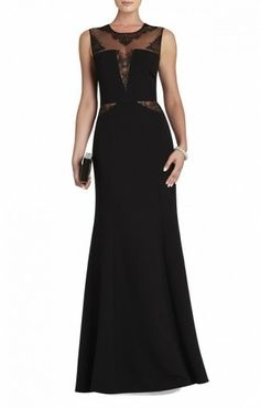 $196.00 Elegant, confident and fabulously femme-fatale, this lace-detail gown is an absolute must-have for show-stopping looks. Round neck. Sleeveless.Lace detail at neckline, bodice and waist. Solid panels at bodice.Sheer insets at waist. Keyhole at back.Concealed center back zipper with hook-and-eye closure.Crepe: Polyester. Tulle: Polyester. Crepe de chine: 100% Silk.Dry Clean.Imported