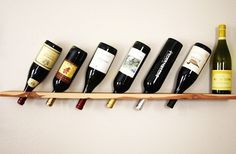 Claire from Camille Styles created this simple wine rack with a Forstner bit and a single plank of cedar. Some measuring, some holes, and boom! A wall-mounted wine shelf.