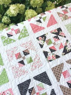 Carried Away Quilting pattern: Window Garden featuring Olive's Flower Market by Lella Boutique for Moda.  Layer Cake Quilt.