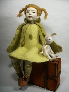 The doll is needle felted (or dry felted) with no armature. It is made fully out of wool. The eyes are plastic. To tone the doll face I used coloured wool. The clothes are made of wool,hair is made of merino wool. The doll is pose-able with no support. Her pose is permanent and she is not a toy, so should not be used as such. Height 27 cm. Price is for the whole composition.   Sincerely,Elena.