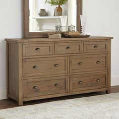 A handsome addition to your master suite or guest room, this wood dresser showcases a light toffee finish and cup drawer pulls.