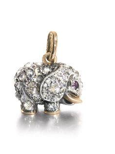 Faberge jewelled gold elephant pendant with rose and circular cut diamonds and ruby eyes