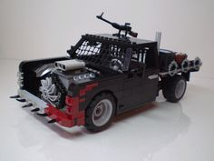https://flic.kr/p/71CMMT | Post-Apoc Flatbed Truck | Entry for the 23rd LUGNuts challenge.  This is a zombie-killing masterpiece! A small flatbed truck complete with high caliber machine gun, armor, spikes, and a dangerous exposed engine bay with a razor blade fan!  Blood splatters for authenticity!