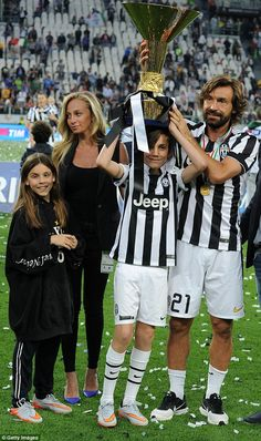 Pirlo and his family celebrate winning a fourth consecutive Scudetto after the game with N...