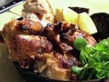 The Standard Grill Million Dollar Chicken.  Serve in a cast iron skillet, elevate bread, lemon & mach
