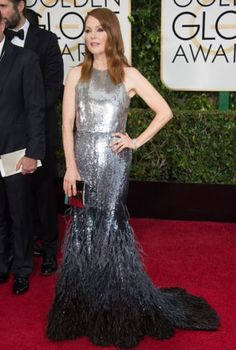 Julianne Moore is wearing Givenchy Haute Couture by Riccardo Tisci custom gown with Chopard jewelry.
