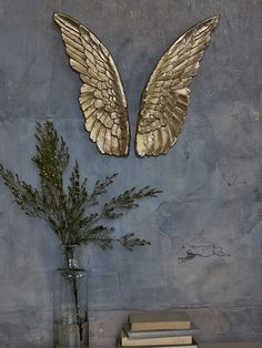 A statement piece for an eclectic interior, our set of elegant soft gold angel wings can be hung or propped against a wall to suit your taste. Crafted from durable resin, each wing has a unique shape and intricate, feathered pattern, complete with rustic details for an aged effect. Place on your mantelpiece or hang above a console table for a bold decorative touch.
