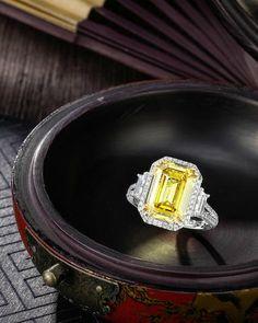 A 5.01 carats Fancy Deep Yellow Diamond and Diamond Ring