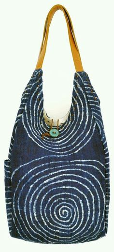 I love the way the design on the fabric and the shape of the bag go together.