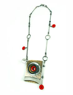 """Cyclops Necklace, 2015, Bronze, sterling silver, nickle silver, vintage clarinet parts, epoxy resin, felt, stainless steel, 23ky gold leaf, paint, 3.5 x 2.5 x 1"""" pendant- 20"""" necklace"""
