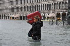 Venice floods: A tourist crosses flooded St Mark's Square