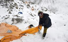 n this photograph taken on April 25, 2015, expedition guide Pasang Sherpa searches through flattened tents in search of survivors after an avalanche that flattened parts of Everest Base Camp