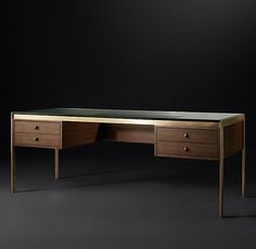 RH Modern's Reynor Desk:Informed by the aesthetic of 1970s Italian design, our desk marries cool metal with the warmth of richly grained wood. Constructed with drawer modules on either side, it's topped with beveled glass.