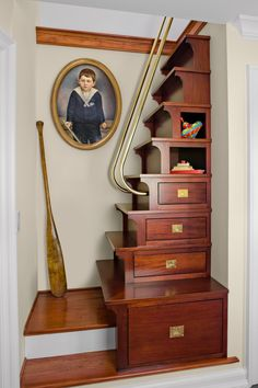 This nautical-inspired staircase with storage cubbies and drawers connects a bedroom to a loft above.