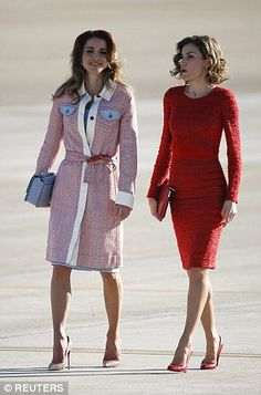 Pulling out the sartorial stops to compete with her royal counterpart, mother-of-two Letizia, 43, stunned in an elegant lace dress in a bold red hue