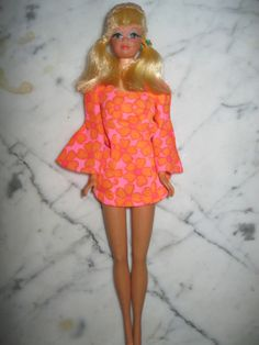 "PJ Barbie, my favorite! I remember wanting her so bad and mom told me ""no"". Dad so happened was going back to Gambles and I asked to go along. I remember, mom saying, now don't you ask for that doll, I said, I won't :) well as dad was chatting with the sales man I went and got her and said daddy can I have her(?), he just smiled and said, sure honey :):):) Dad was always easier than mom."