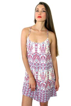 Our knee length paisley dress in white, red and sky blue. Perfect for a special summer day.