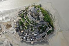 An aerial view shows the Mont-Saint-Michel, northwestern France. Mont Saint Michel France, Le Mont St Michel, Saint Quentin, The Mont, Tourist Sites, The Weather Channel, Small Island, Birds Eye View, Kirchen