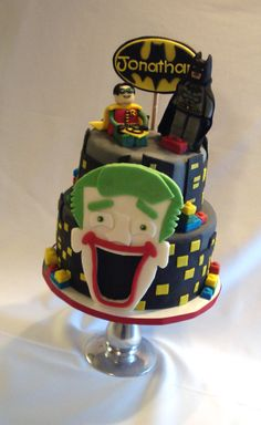 Lego batman Inspired cake: All fondant cake with fondant figures and topper. Gumpaste Joker face
