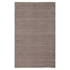 Stylishly anchor your living room seating group or master suite ensemble with this hand-woven cotton rug, showcasing a diamond motif in brown.