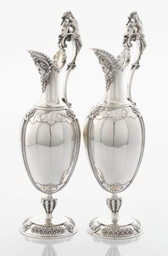 A PAIR OF VICTORIAN SILVER WINE JUGS. John Wilmin Figg, London, England, 1868-1869.