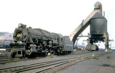 Pennsylvania Railroad 2-10-0 Decapod, I1 class, steam locomotive # 4521, is seen near a railroad coaling tower at East Altoona, Pennsylvania, September 16, 1955, John Dziobko Jr. Photo