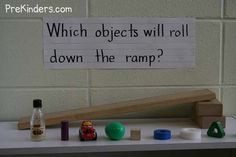 """Science Center- Prekinders.com   """"I built the ramp ... and added items to test whether they roll or do not roll. The items were: Cracker Barrell mini syrup bottle, small cylinder block, small toy car, plastic egg, wooden cube, wooden wheel, roll of tape, wooden triangle, and a round craft pom pom. We also have different materials to put on the boards, such as bubble wrap, wax paper, and sandpaper for the children to test which materials help or prevent cars from rolling down."""""""