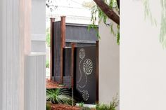Laser cut decorative metal garden gate in a 'Kuru' design. Designed & installed by Paal Grant. Black Rock, Vic location.