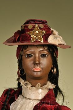 Large Roullet & Decamps Magician Automaton, France, c. 1890, a black female magician with brown-tinted bisque character Jumeau flange head stamped Depose Tete Jumeau 10, http://www.skinnerinc.com/auctions/2476/lots/137