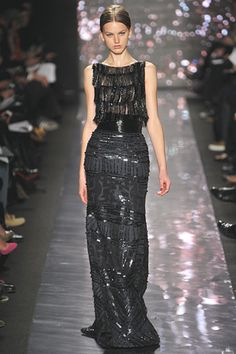 Shame on me.  Before this morning I had not heard of Naeem Khan.  After viewing stills from his recent showing at NYFW and previous collection I am obsessed.  The textures, the patterns, the devotion to evening gowns all make this line inconceivably incredible.