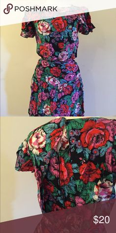 Vintage Dress Fun floral print. Ruching at waist, swing tea length skirt, architectural back panel with zipper and button closure. Feels great! Vintage Other