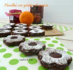 Oggi un buonissimo #biscotto #gluten-free al #cacao e con la Gelatina di #arance. Uno tira l'altro. http://www.ipasticciditerry.com/fiorellini-gelatina-arance/