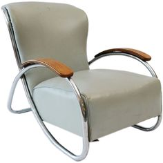 Lounge Chair by K.E.M. Weber Kem Weber was a furniture and industrial designer, architect, art director, and teacher who created several iconic designs of the 'Streamline' style. Born: 1889, Berlin, Germany Died: 1963, California