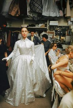 Backstage at the Pierre Balmain couture show, Paris, 1954.  Photo by Mark Shaw.