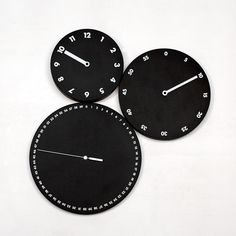 The HMS Wall #Clock comprises three separate clocks that can be mounted any way you like. Originally designed by Dario Serio for Progetti, this three piece design includes one face that marks seconds, one that marks minutes, and a third face that marks each hour. Each clock face is composed of wood painted black with white hands and numbers.
